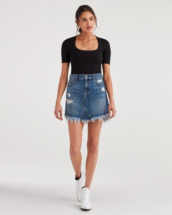 6e805c38c8ba Lyst - 7 For All Mankind Mini Skirt With Destroy in Blue