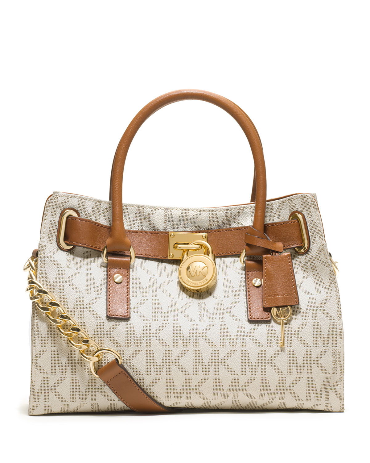 A Michael Kors Jet Set tote crafted in signature logo print PVC with silver-tone hardware, leather trim and a fully lined interior. This Michael Kors Jet Set tote features two main open pockets, a center zip pocket, an interior zip pocket, interior wall pockets and two exterior side slip pockets; two adjustable leather handles with a