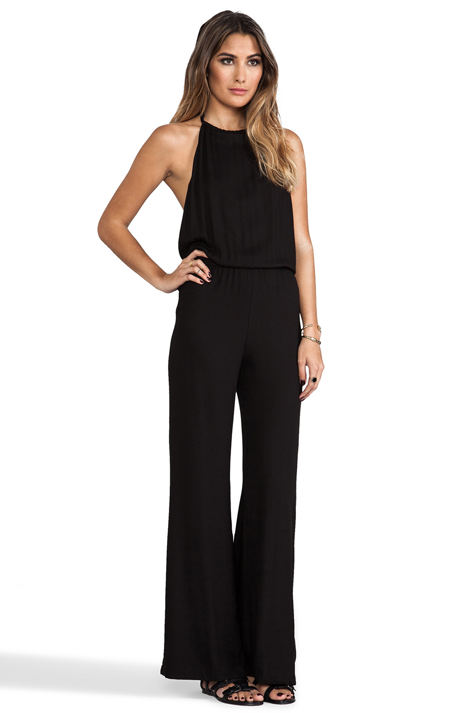 This wide leg jumpsuit is all business in the front, while the open back is ready to report2day.ml back closureElastic waistCrepe wovenOnline only.