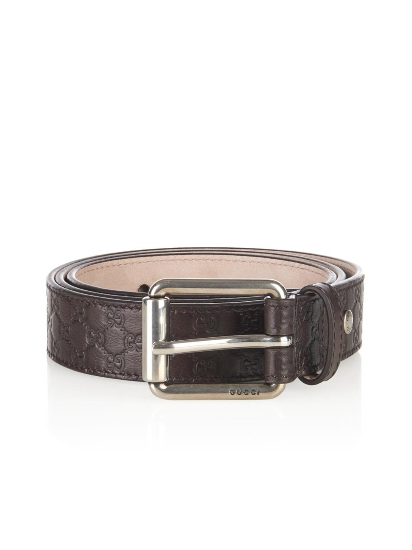 gucci debossed logo leather belt in brown for lyst