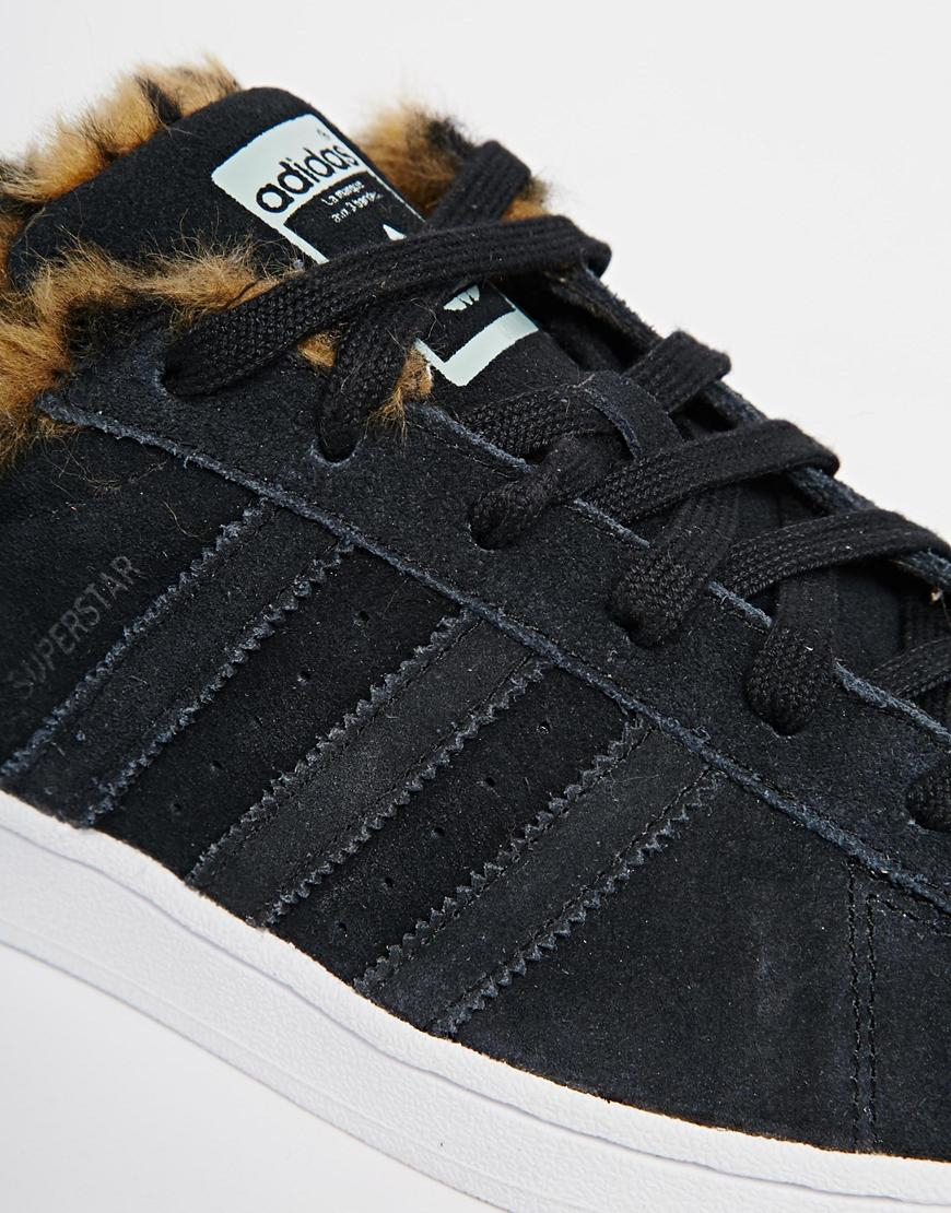 Lyst - adidas Originals Superstar Faux Animal Fur Trainers in Black 53acd5ac5