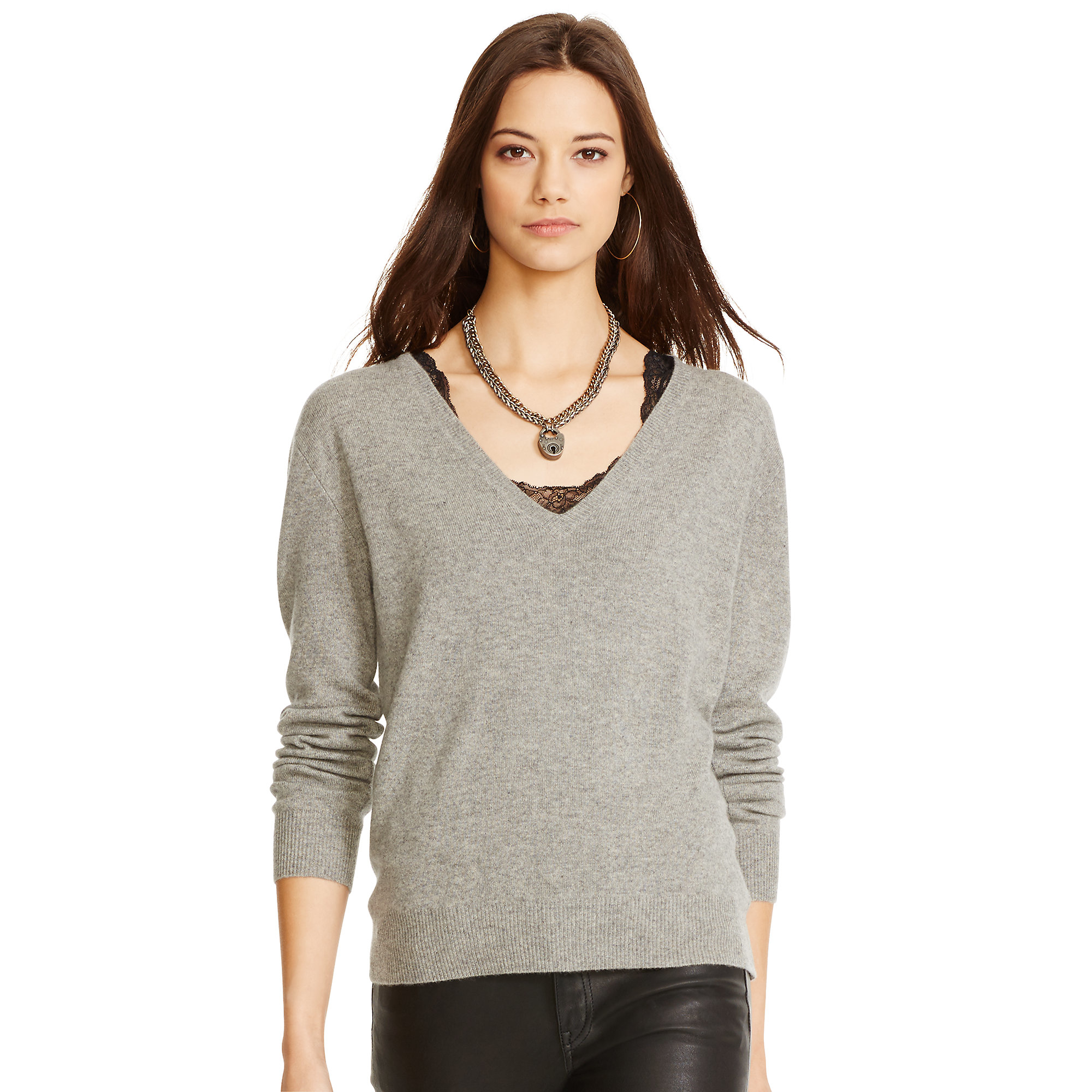 Our pullover tunic is knit with directional stitches and subtle allover texture. A chevron pattern at the center front adds even more surface interest.