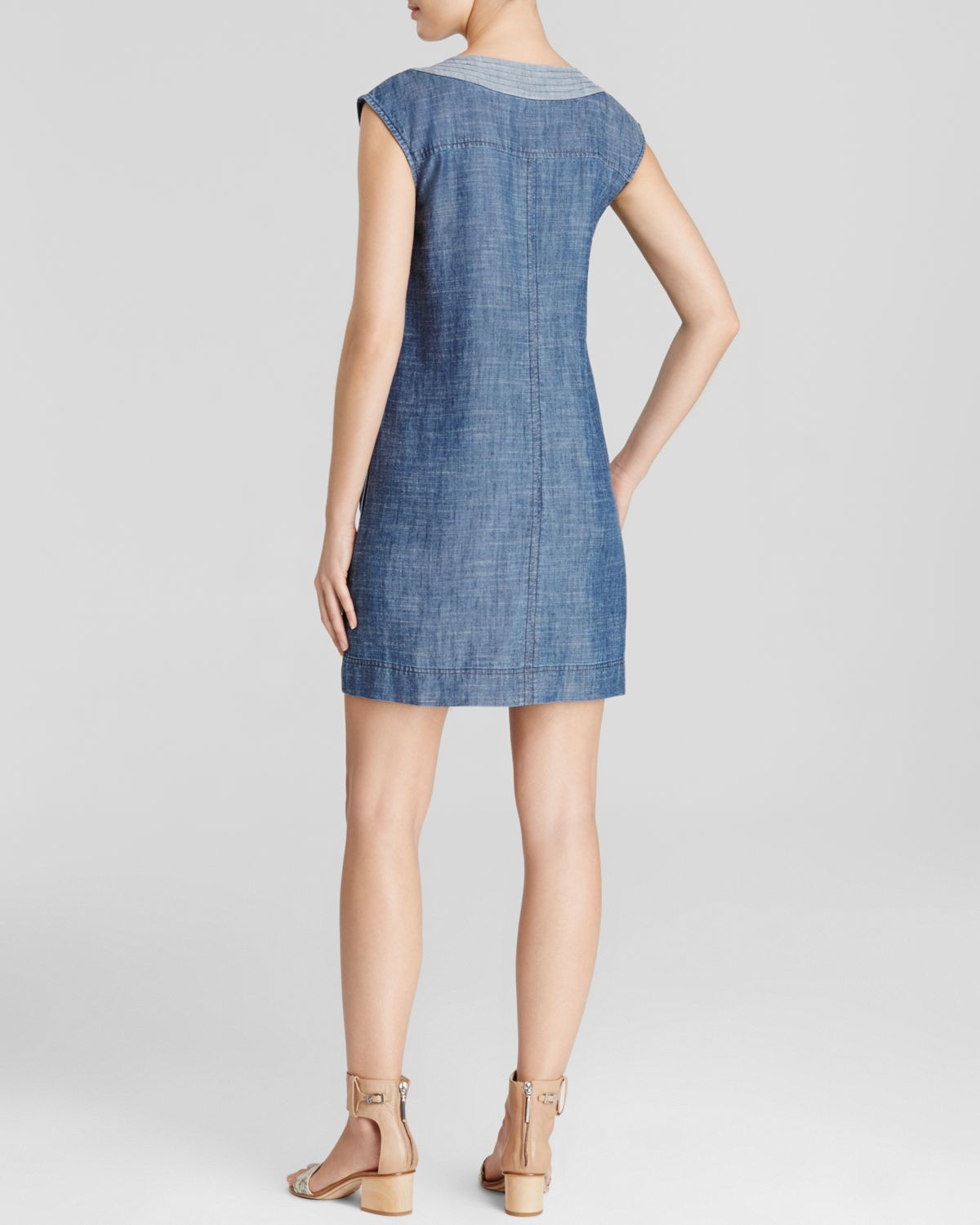 Description & Details. The most comfortable, garment-washed, chambray denim dress is embroidered for extra polish. Open collar. Stitched center front placket and cuffs secured with shell buttons.