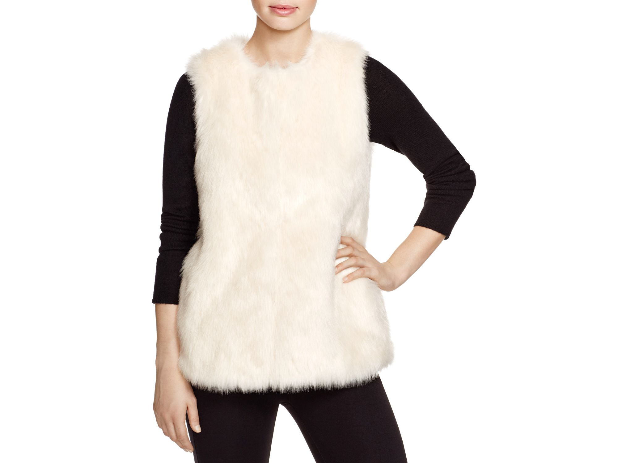 Faux Fur Vest: Ultra-soft and incredibly versatile, our faux fur vest is plush, warm and has a shawl collar, side pockets and three hidden clasp closures. It pairs well with so many styles and keeps you looking classically cozy all season long.