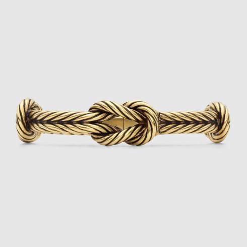 b60cd54a9934a Gucci Metallic Gold Finished Silver Knot Bracelet