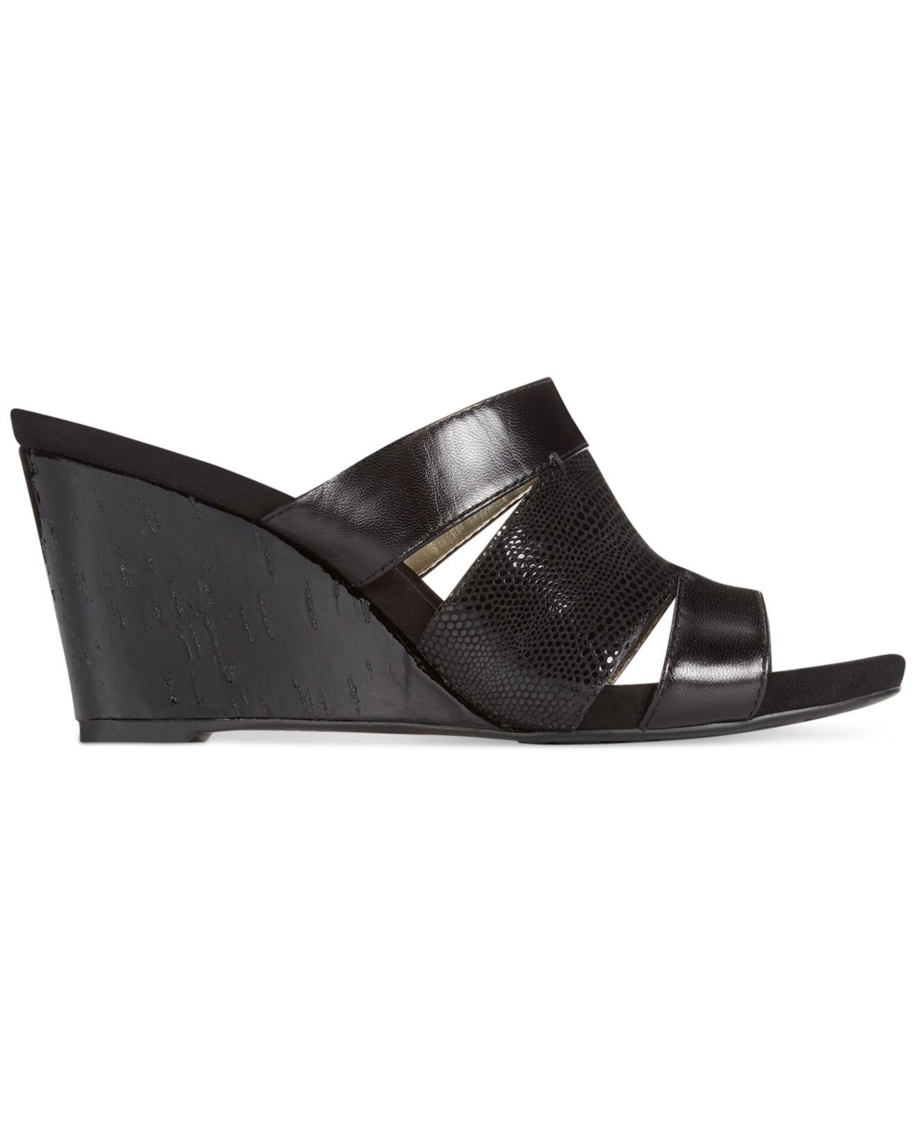 422104834e2 Lyst - Anne Klein Loopy Wedge Sandals in Black