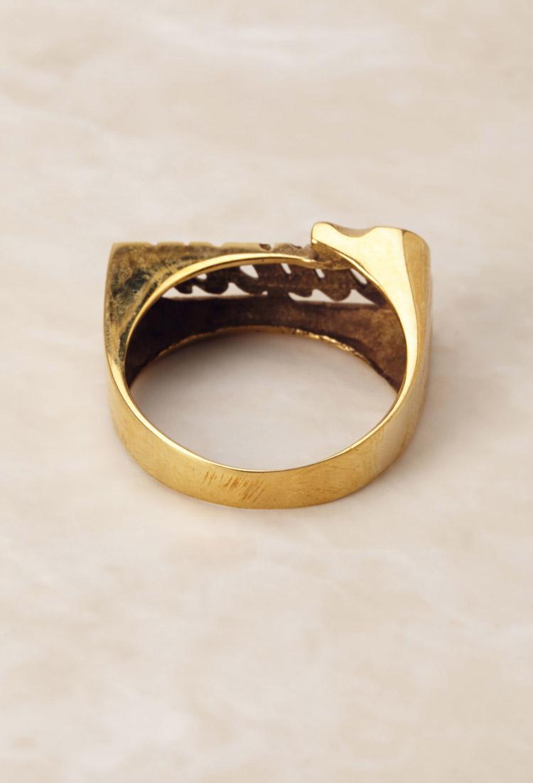 Tupac gold rings