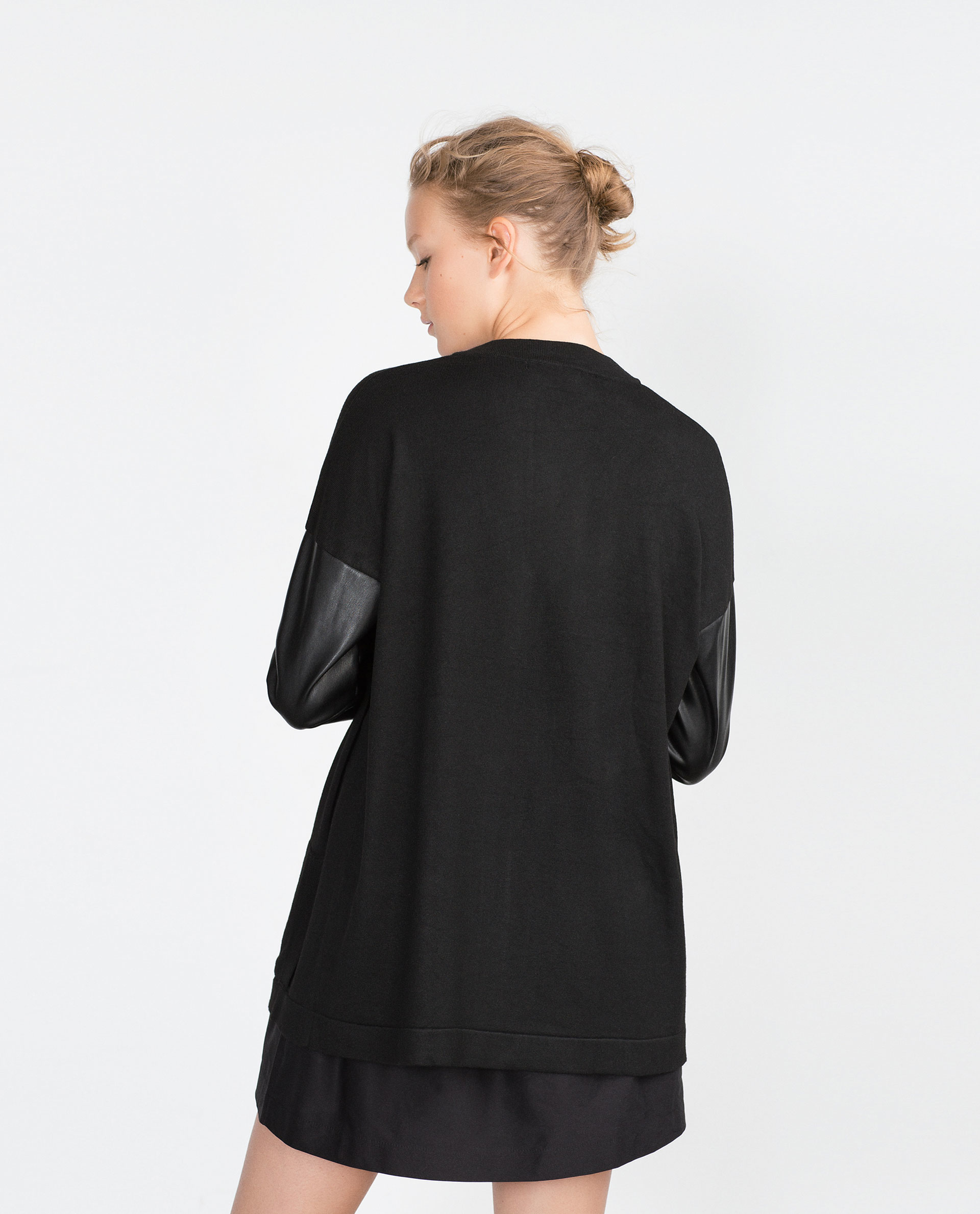 Not the type of blazer you'd wear to a 9 to 5; more like 5 to whenever! The black ponte body has a tailored look, with seaming detailed onto the draped front. The black faux leather sleeves lend an after-midnight vibe, with a sleek and smooth look.