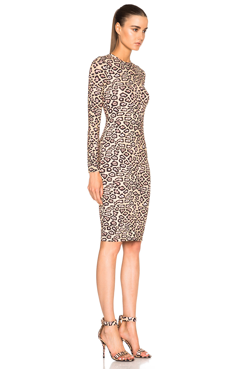 """LONG ANIMAL PRINT DRESS Details. Tan - / Dress with shirt collar and long sleeves with buttoned cuffs. Front button closure and tie detail at waist. MODEL HEIGHT: 5' 10"""" ( cm) 2. Choose a size Select a size. XS. S. M. L. XL. XXL. Size guide. 3. Add to cart."""