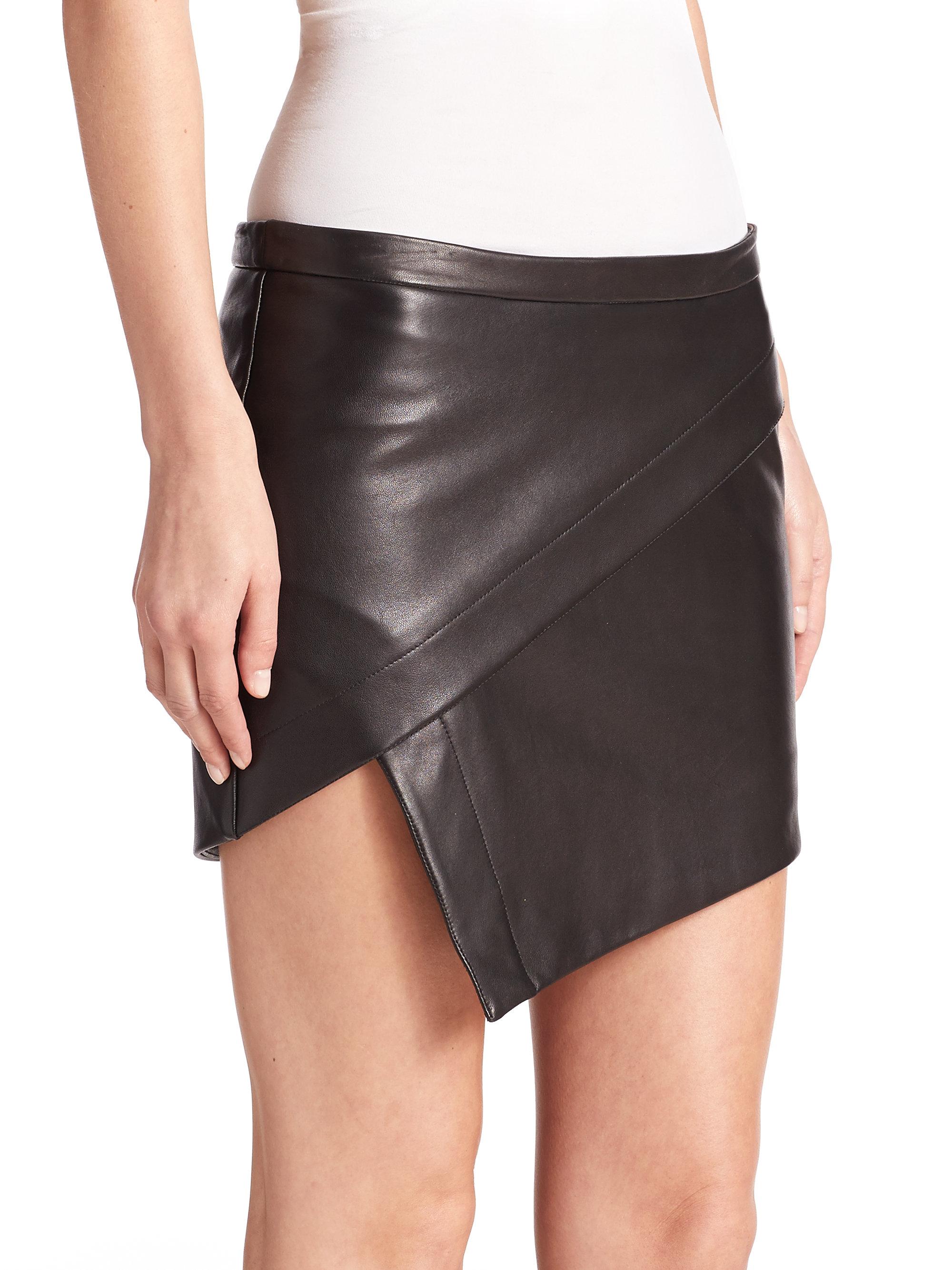 by black asymmetrical leather mini
