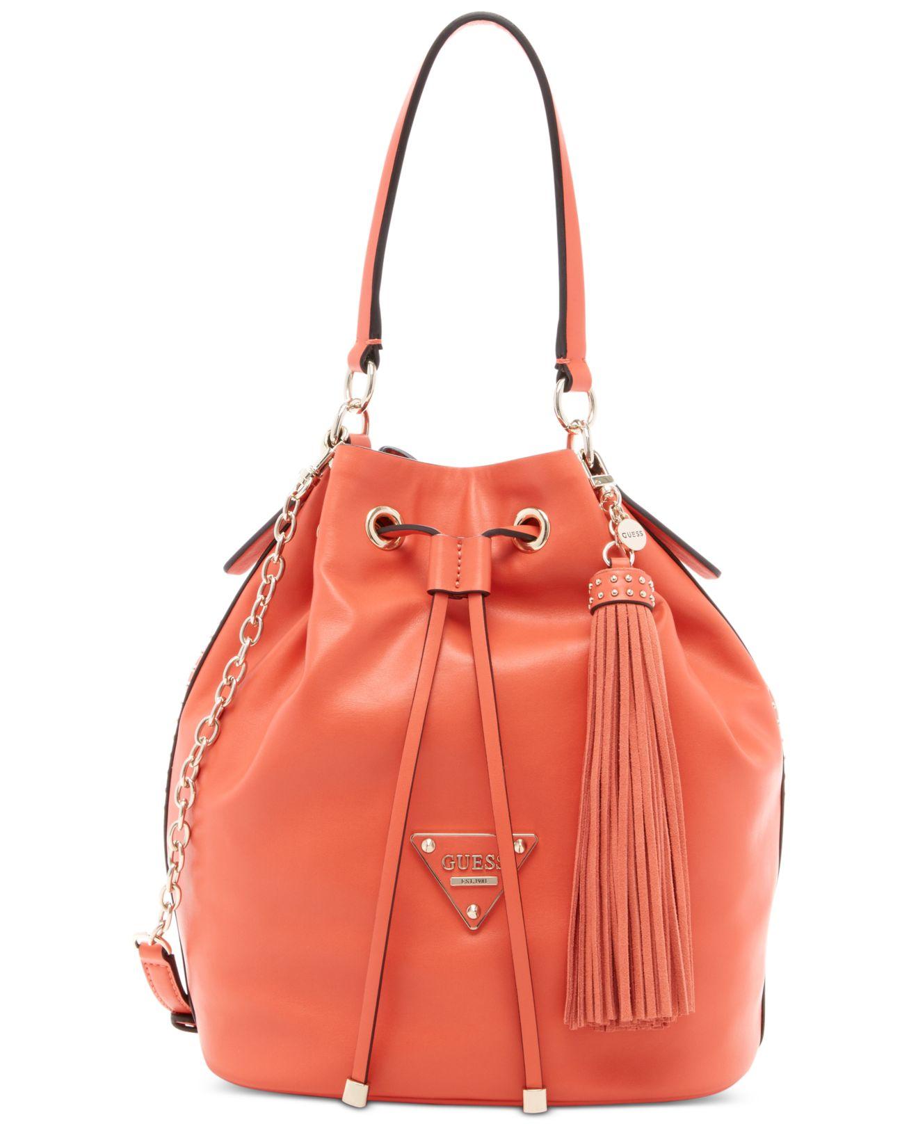 d9e4745a3c Lyst - Guess Thompson Drawstring Bucket Bag in Orange