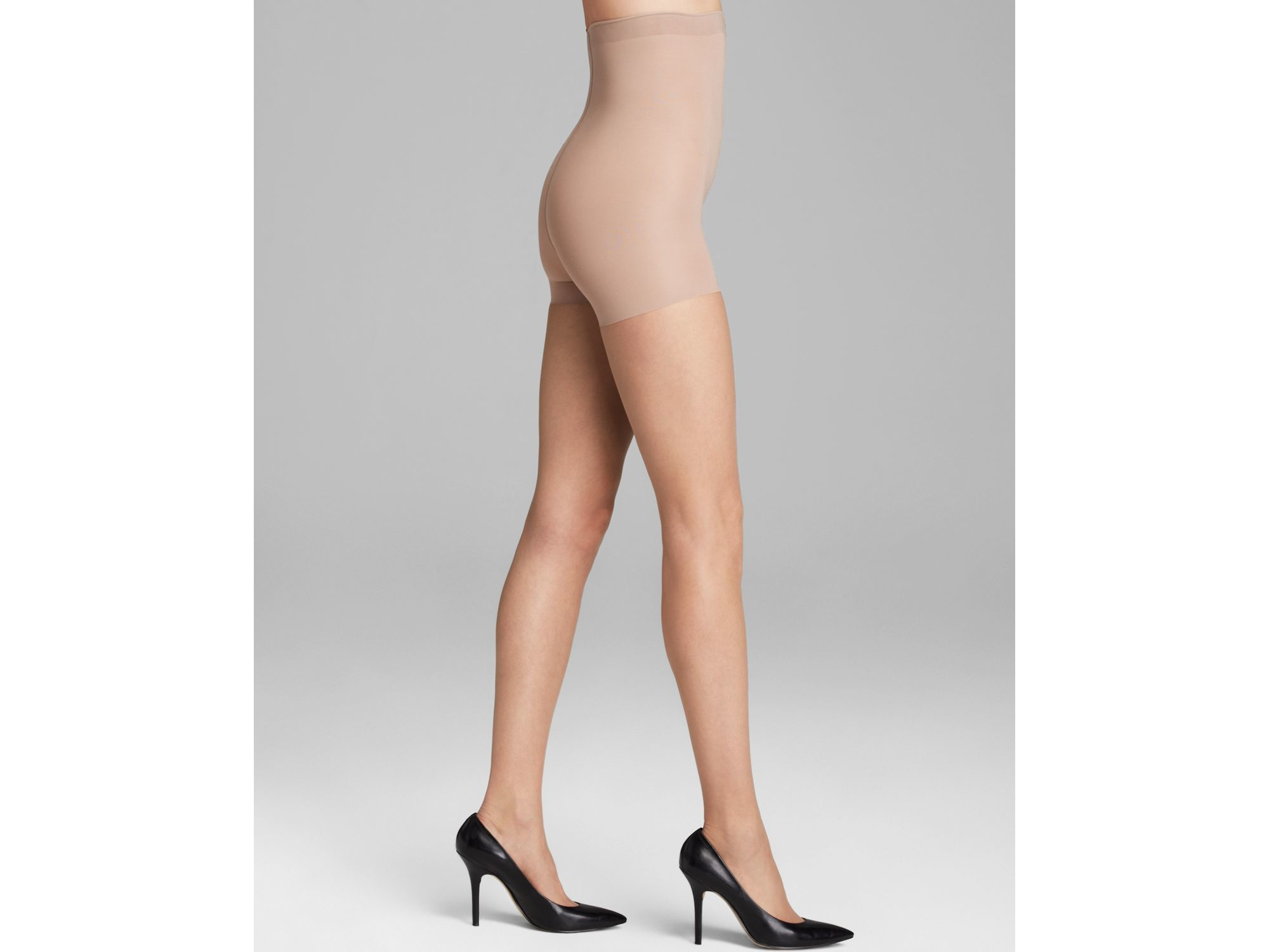 0cc2d58ad00cd Lyst - Donna Karan The Nudes Collection High Waist Toner Tights in Brown