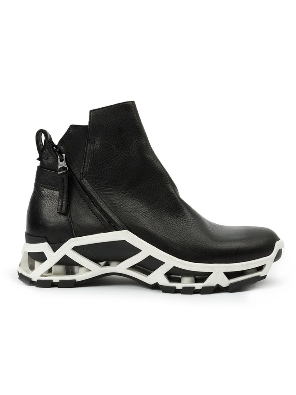 cinzia araia hi top zip sneakers in black for lyst