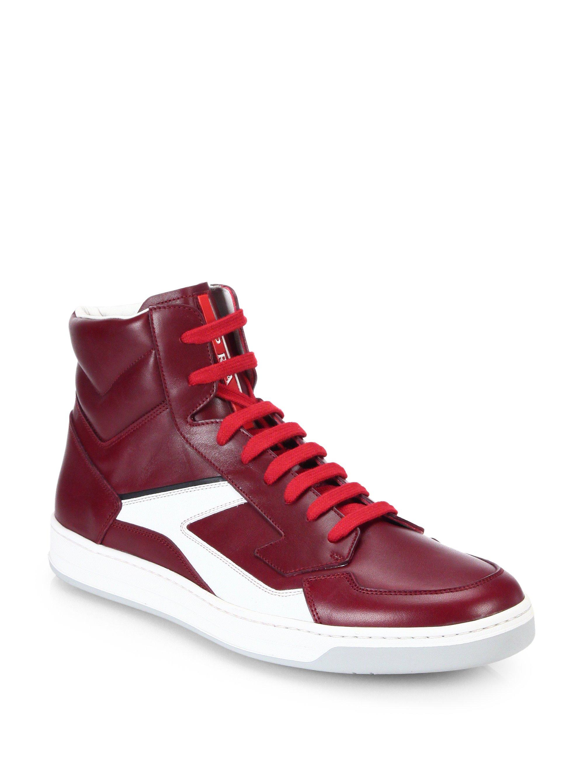 lyst prada leather hightop sneakers in red for men