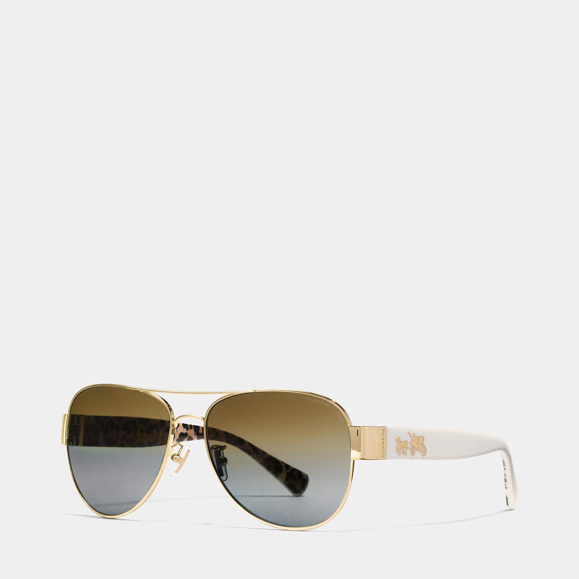 d51d8e7d315 Lyst - COACH Horse And Carriage Pilot Polarized Sunglasses in Metallic