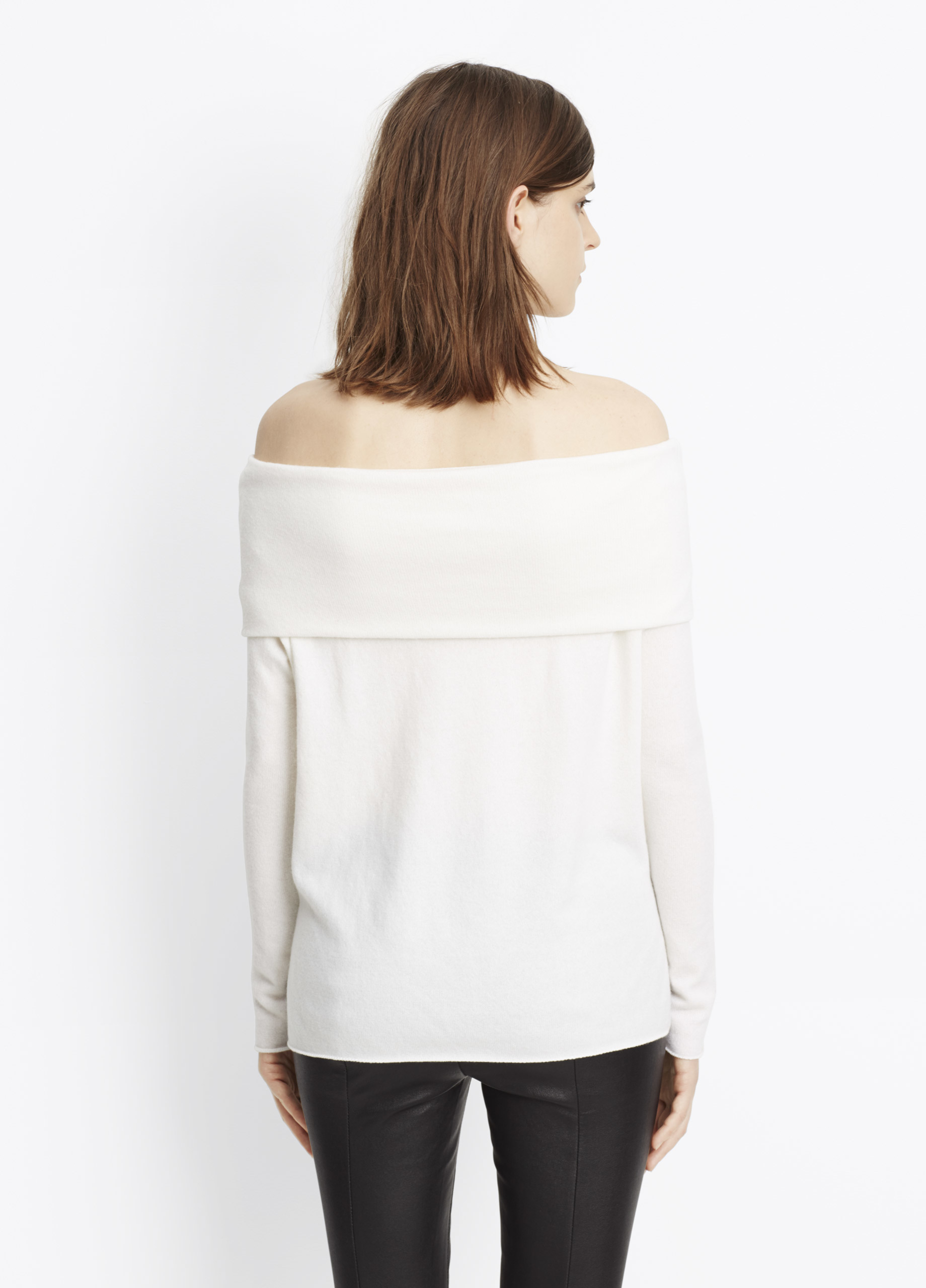 The off the shoulder design includes a straight cut neckline that includes sleeves that appear detached from the rest of the garment. Simple to care for, and available in three different colors, this is the blouse that wil instantly become your favorite throughout the summer.