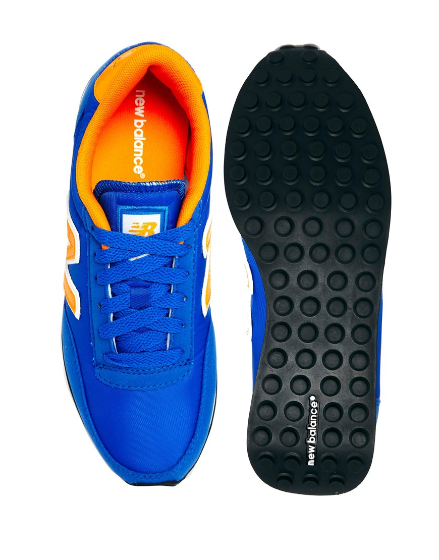 new balance blue yellow 410 sneakers