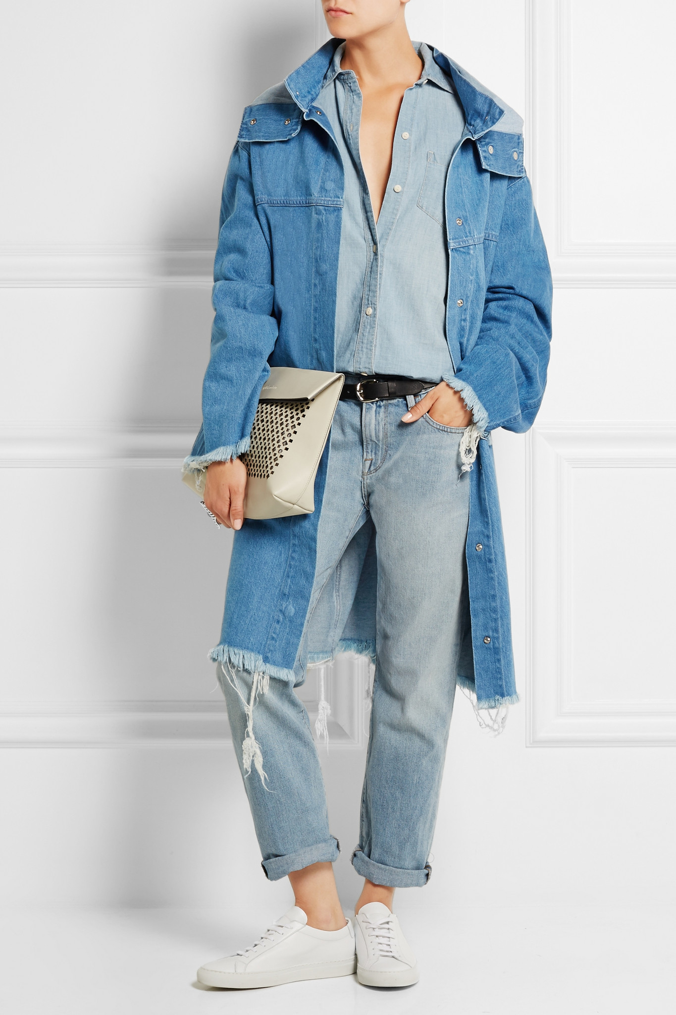 Vetements' denim jacket looks as though it's layered over a sweatshirt - it's actually fitted with a light-gray cotton-jersey drawstring hood. Cut for an oversized fit that's become a brand signature, it looks as much a rare vintage find as a cult streetwear piece, in fact, no two appliqués are the same.