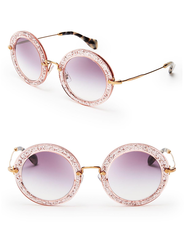d7660990c8ec Lyst - Miu Miu Noir Round Sunglasses in Pink