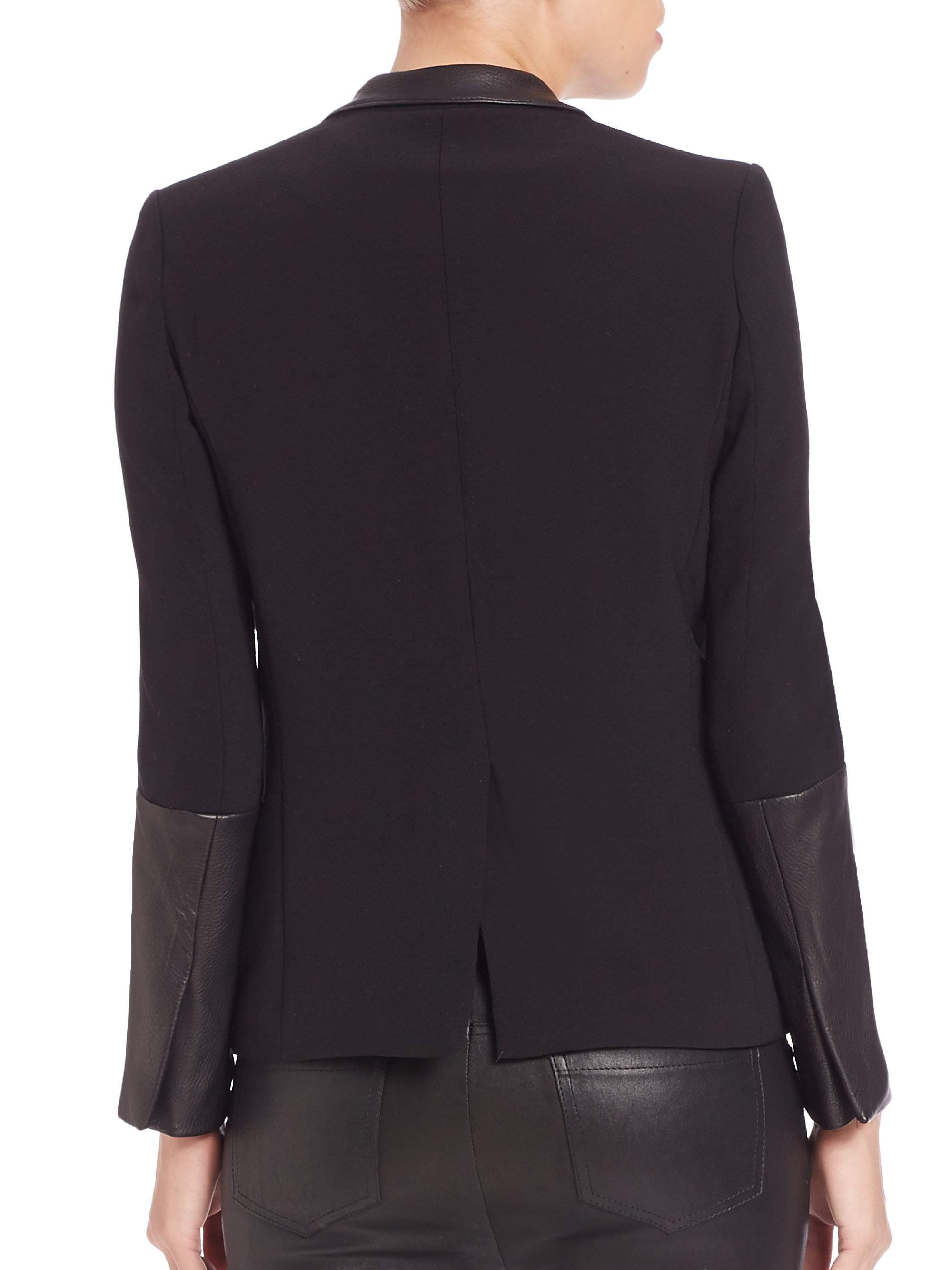 Woven fabric Faux leather trim detail Long sleeve Open front Side zip pockets Our model wears a UK 8 and is cm/5'9