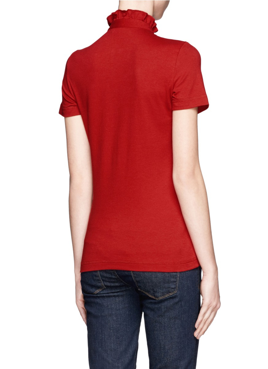 Lyst tory burch lidia ruffle polo top in red for Tory burch fashion island