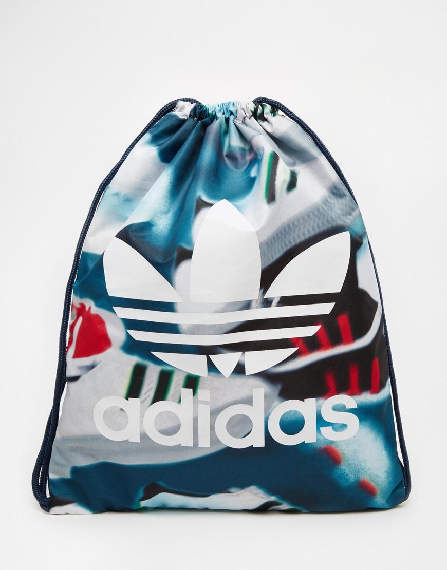 0779ba5114e Lyst - adidas Originals Drawstring Backpack In Shoe Chaos Print ...