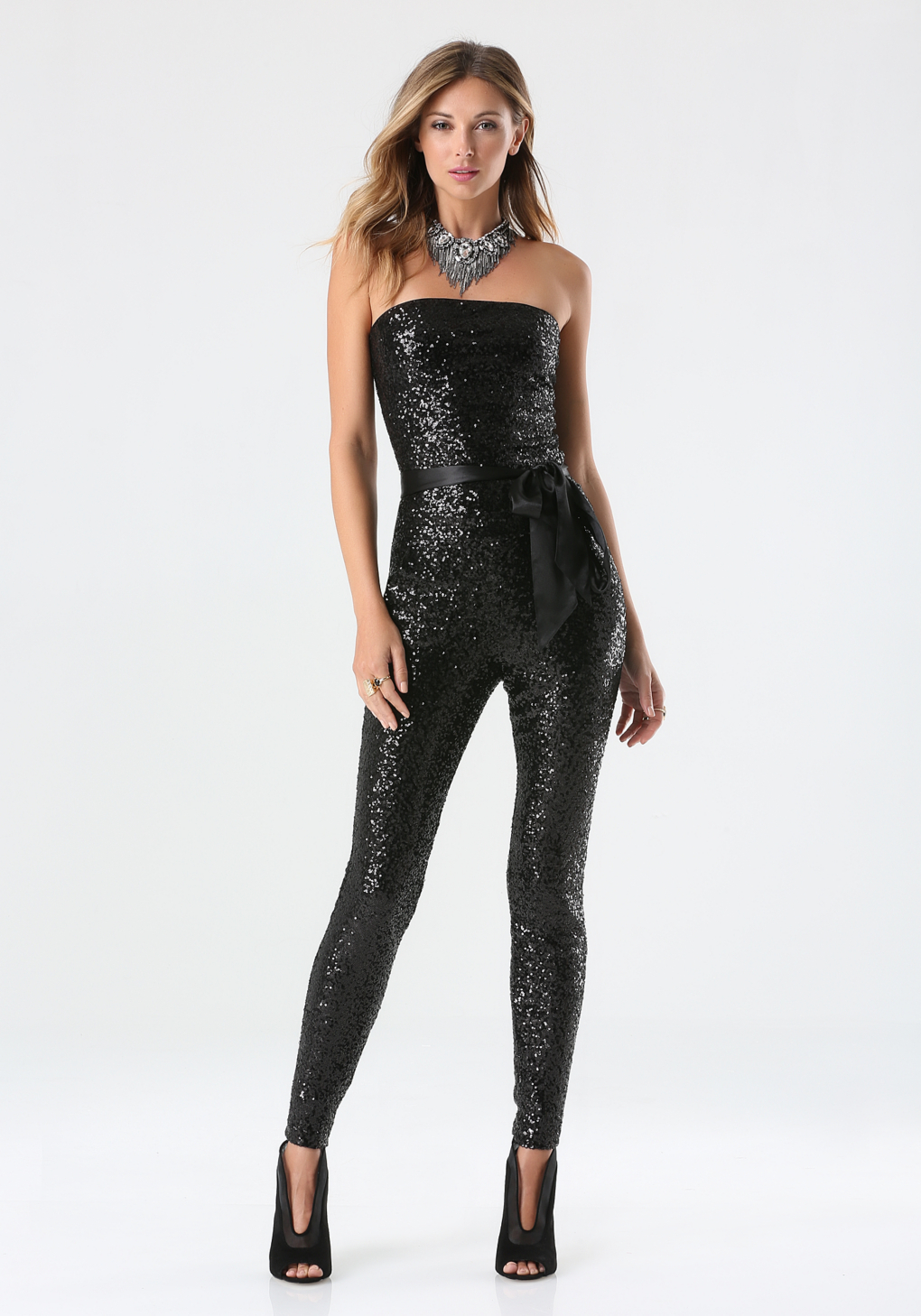 Available In Black Mesh Sequin Jumpsuit Mock Neck With Choker Deep V- Neck Lined With Black Shorts % Polyester.