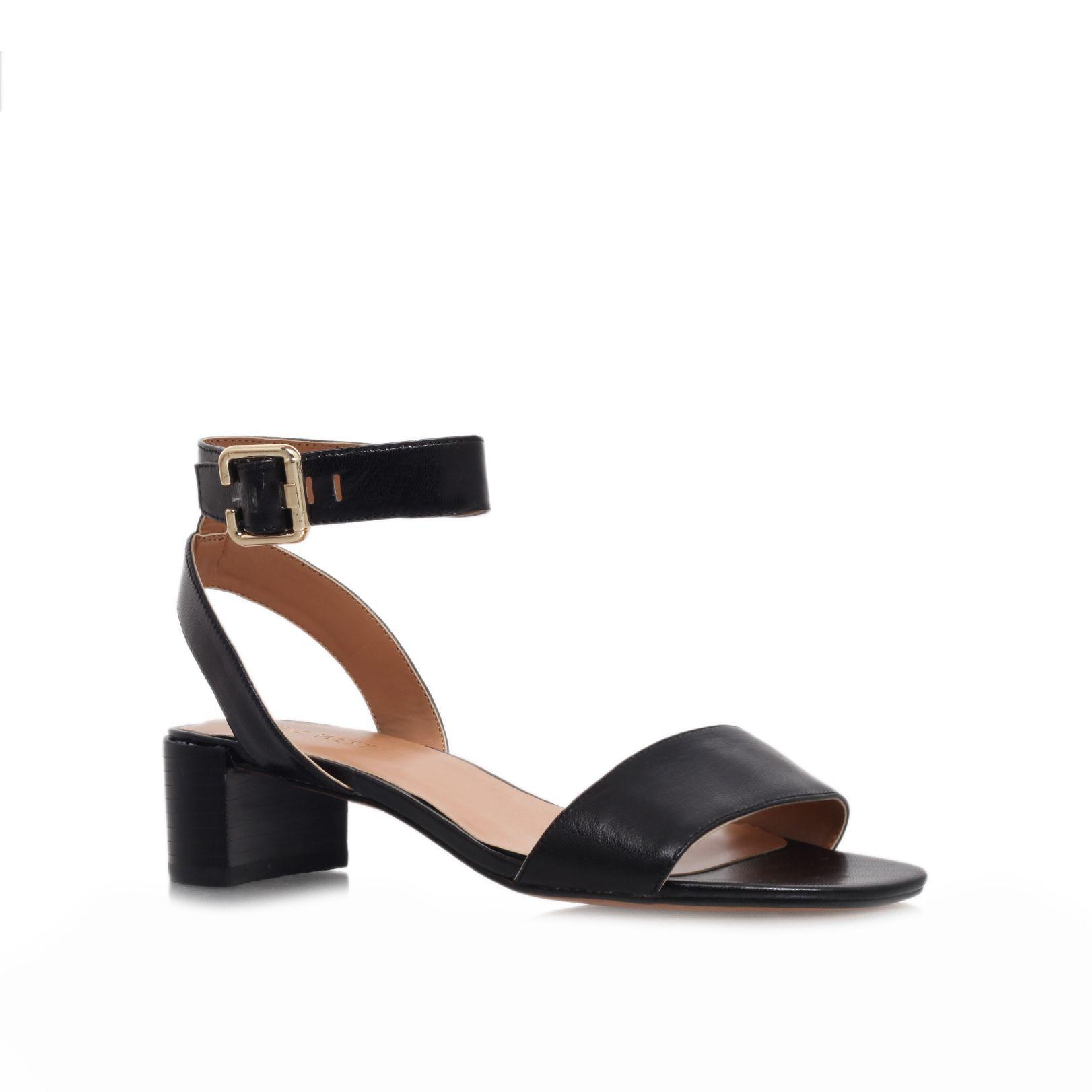 Black sandals with heels - Gallery