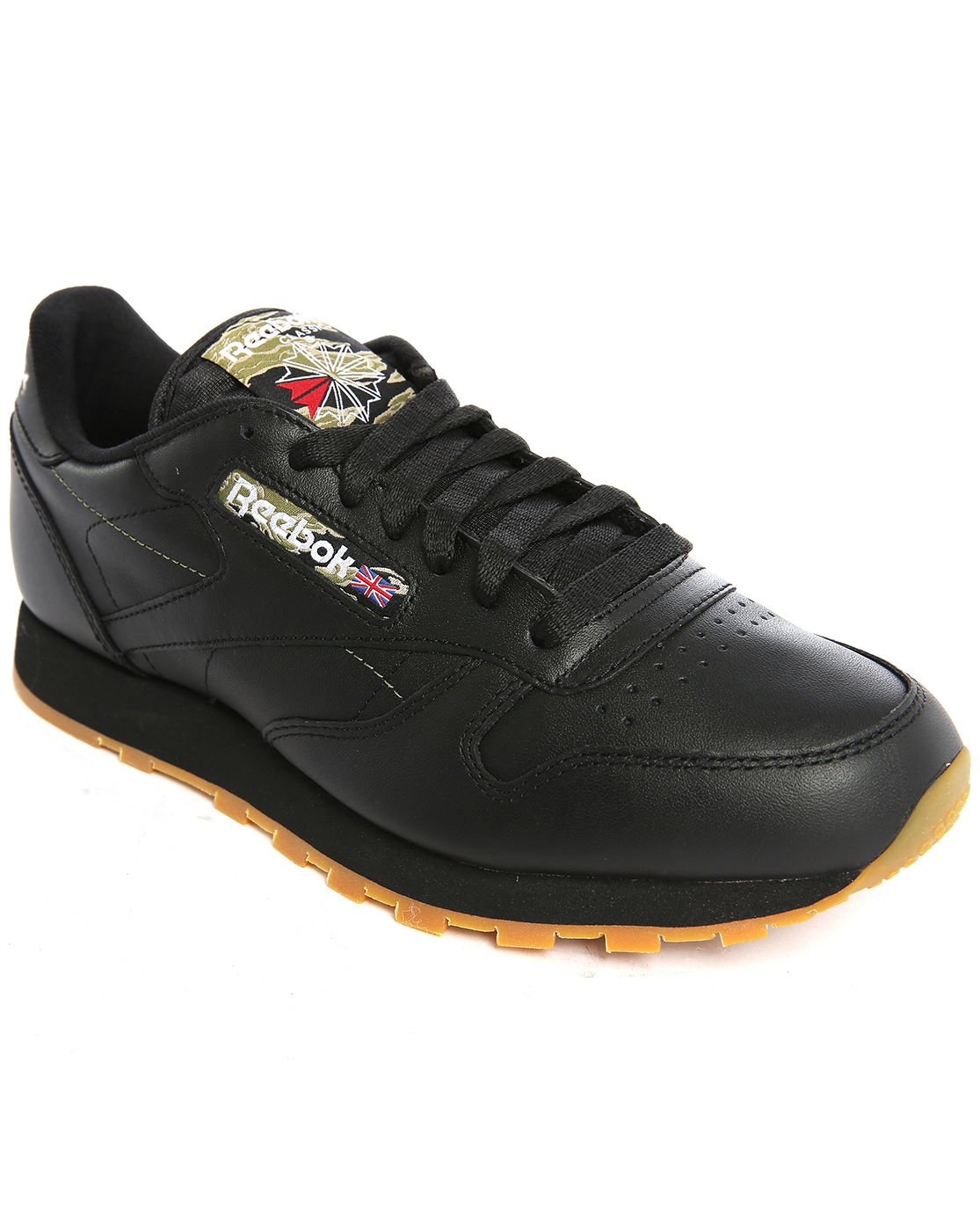 reebok classic black leather gumsole sneakers in black for