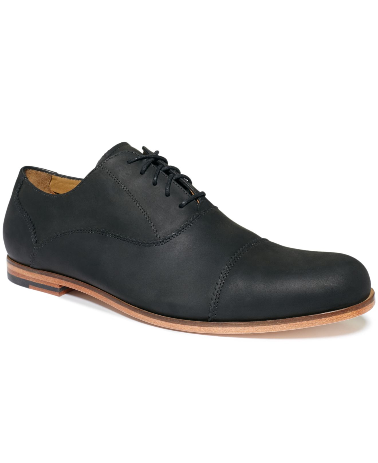 Men's Cole Haan Leather Lace-Up Sneaker. More than footwear the Cole Haan Shapley Sneaker II makes a statement every time you lace up. These smooth leather sneakers are lined with a soft and breathable fabric for abrasion free wear.