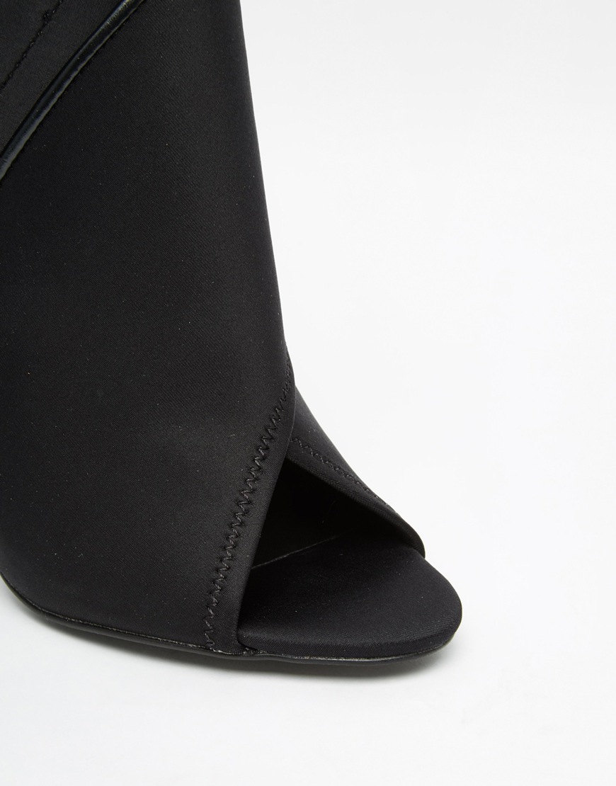 aldo ulycia black zip heeled shoe boots in black lyst