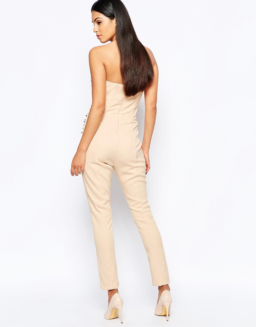 A crepe woven jumpsuit in a chevron pattern, QUICK VIEW WARNING: This product can expose you to chemicals, including lead and/or phthalates, which are known to the State of California to cause cancer and birth defects or other reproductive harm.