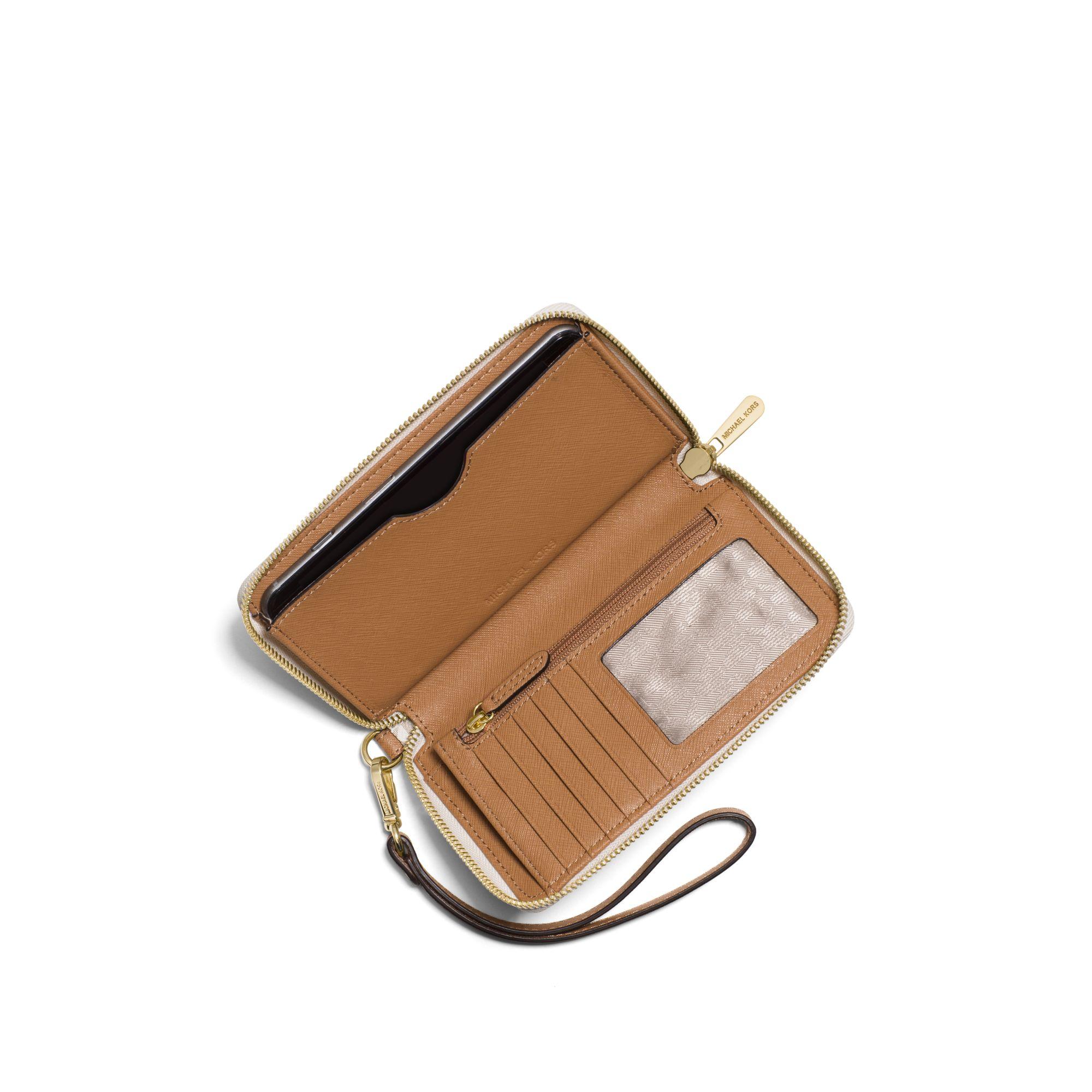 614e7f6da25308 Michael Kors Travel Smartphone Wristlet in White - Lyst