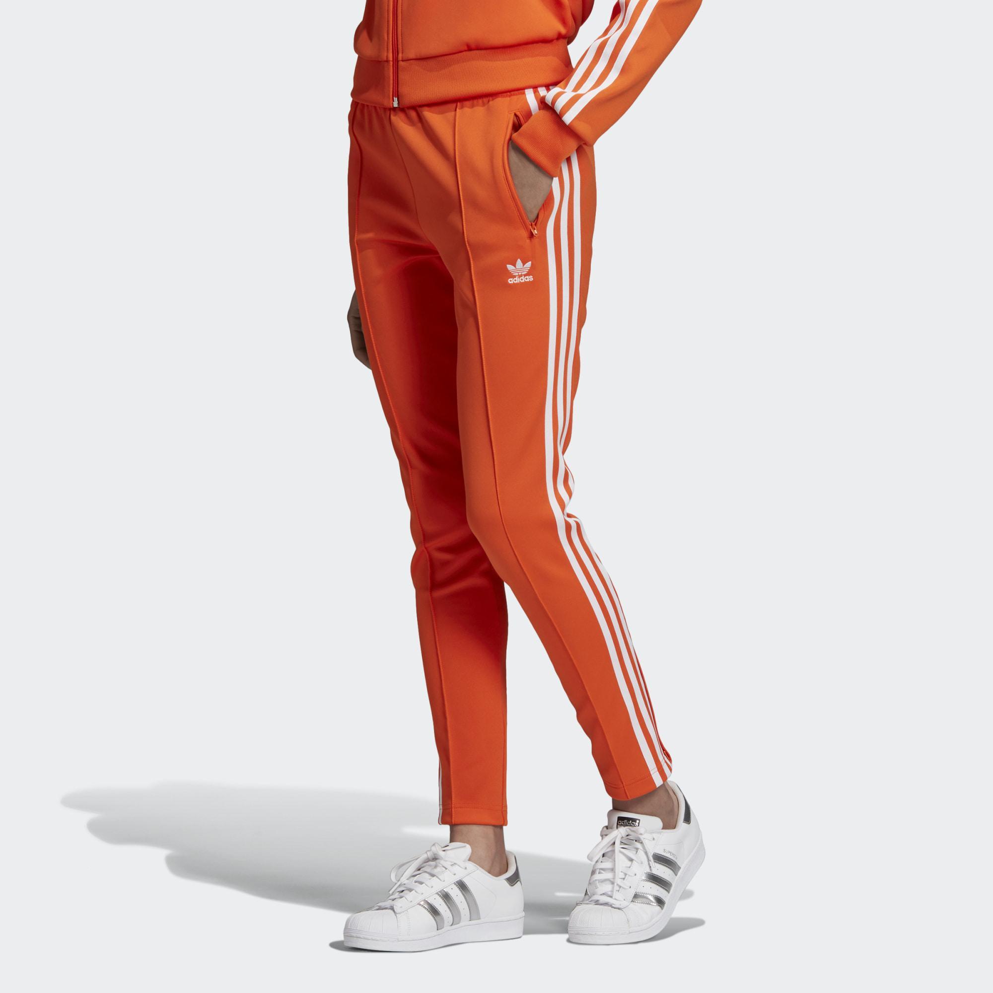 مشتبه فيه تعليق نص adidas oranje broek