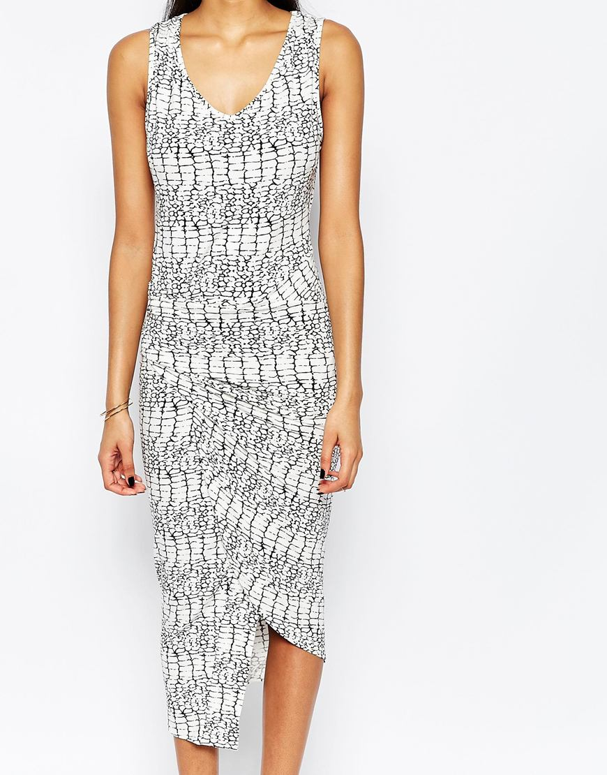 Lyst - Liquorish Asymmetric Maxi Dress In Animal Print in White 0a7133f83