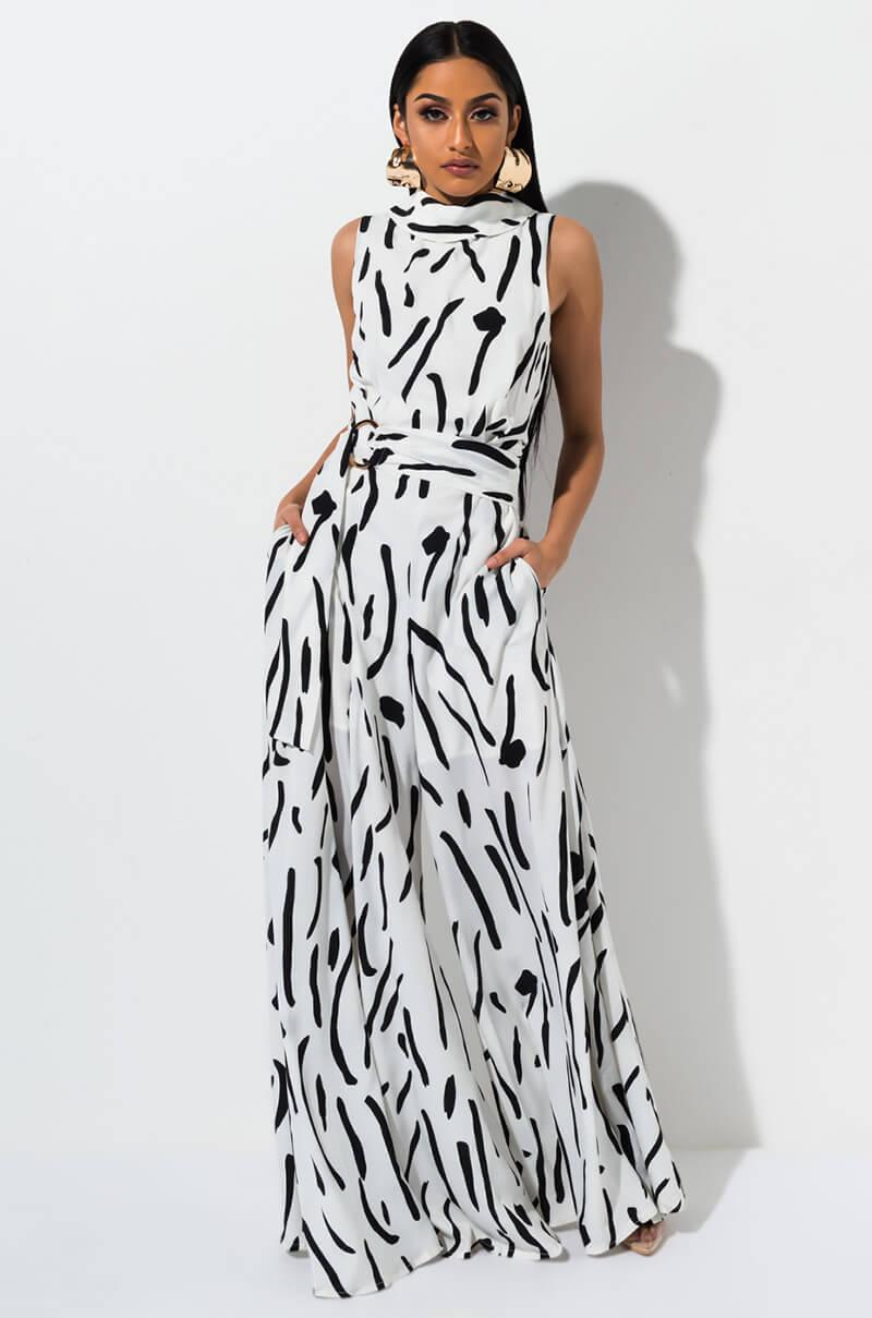 4d077f53d0c Lyst - AKIRA Pardon My French Printed Jumpsuit in White