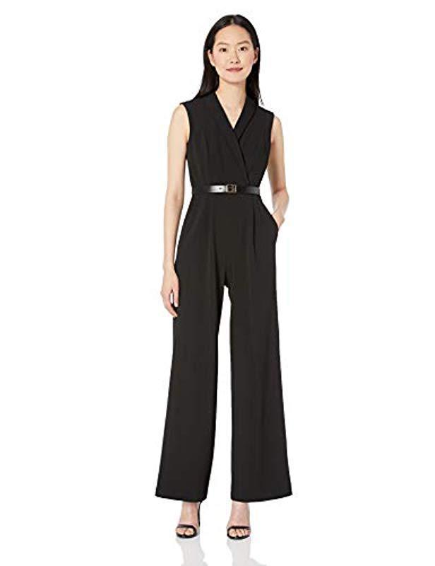 92b90583f1 Calvin Klein. Women s Black Sleeveless Belted Jumpsuit With V Neck Collar