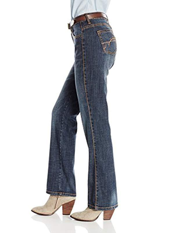 d18dfacbbbc Lyst - Wrangler Aura Instantly Slimming Mid Rise Boot Cut Jean in Blue