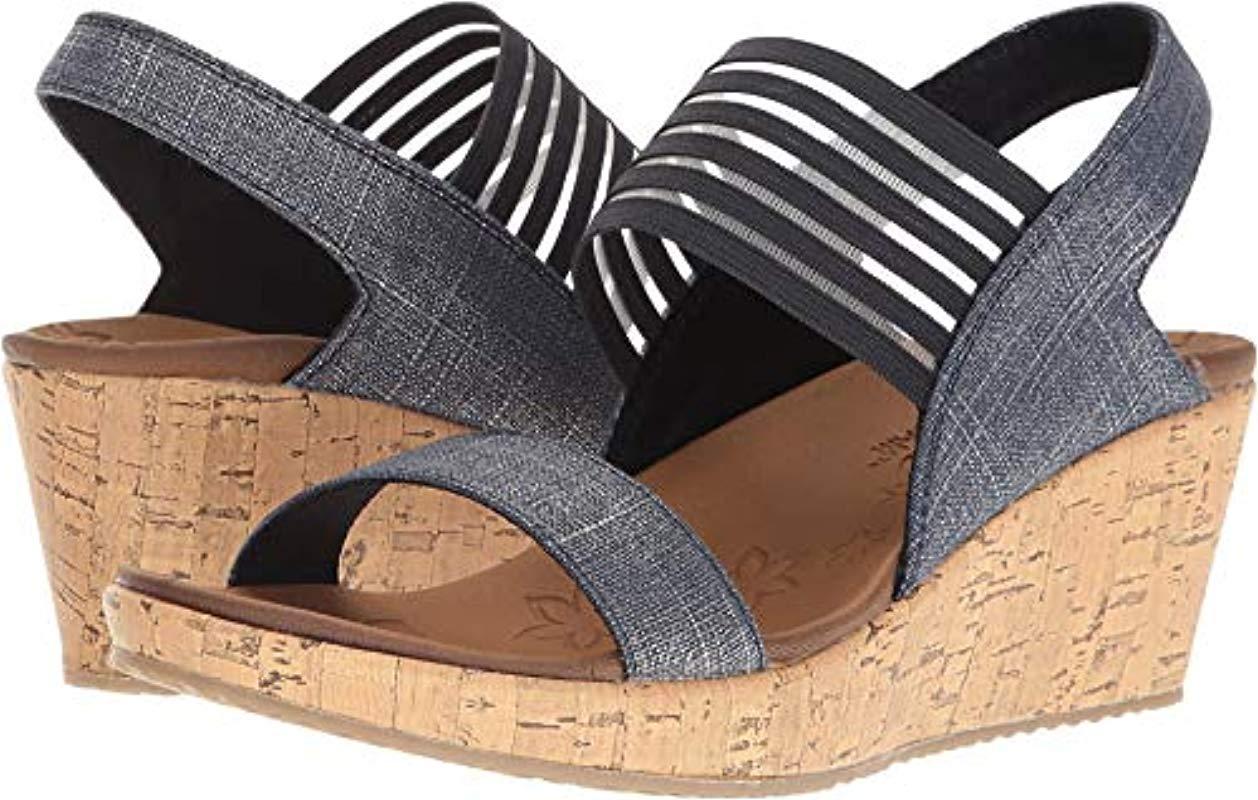 20c01a50f7d8 Lyst - Skechers Cali Beverlee Smitten Kitten Wedge Sandal in Blue