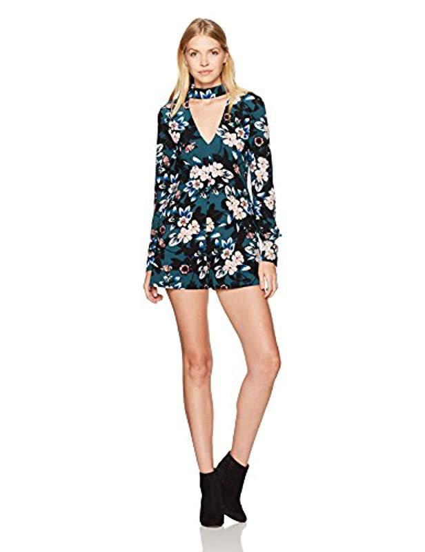 f01bbd14cbc5 Lyst - Guess Long Sleeve Dora Choker Romper in Blue - Save 49%