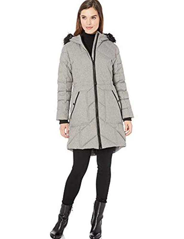 GUESS Womens Knee Length Heavy Puffer Coat with Faux Fur Trimmed Hood