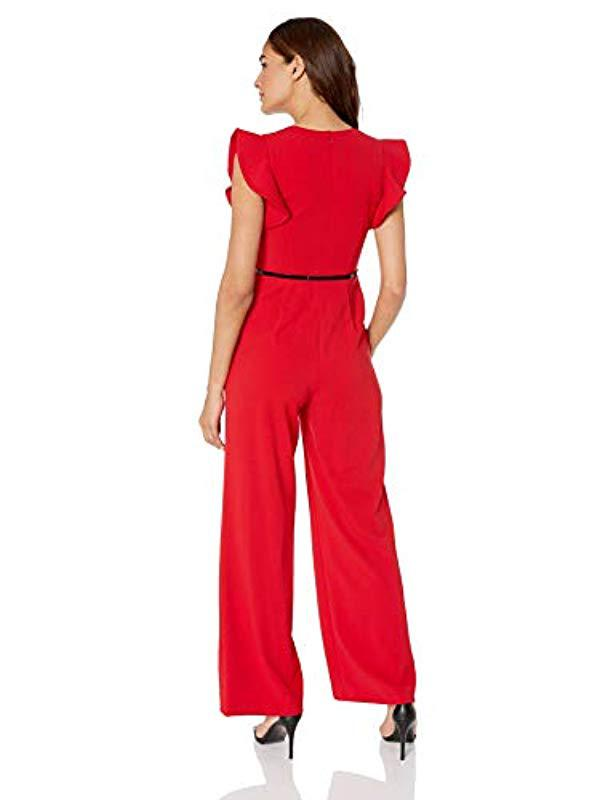 f38a1a2659d Calvin Klein - Red Belted Jumpsuit With Flutter Sleeves - Lyst. View  fullscreen