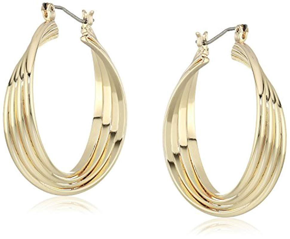 89c5cc3c41a80 Women's Metallic Kenneth Cole New Trinity Rings Gold Medium Twisted Hoop  Earrings