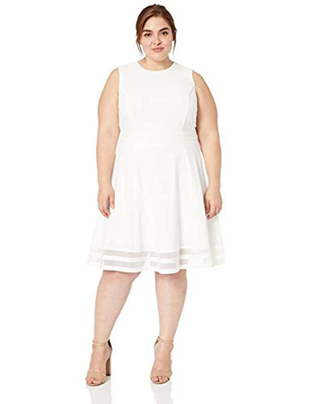 Women\'s Plus Size Fit And Flare Dress With Sheer Inserts At Hem