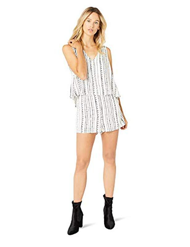 422d61709cb Lyst - Cupcakes And Cashmere Joann Dotted Stripe V-neck Romper