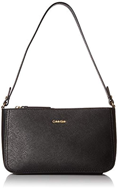 a3b4089ffc2 Calvin Klein Saffiano Leather Demi Shoulder Bag With Charm Hanger in ...