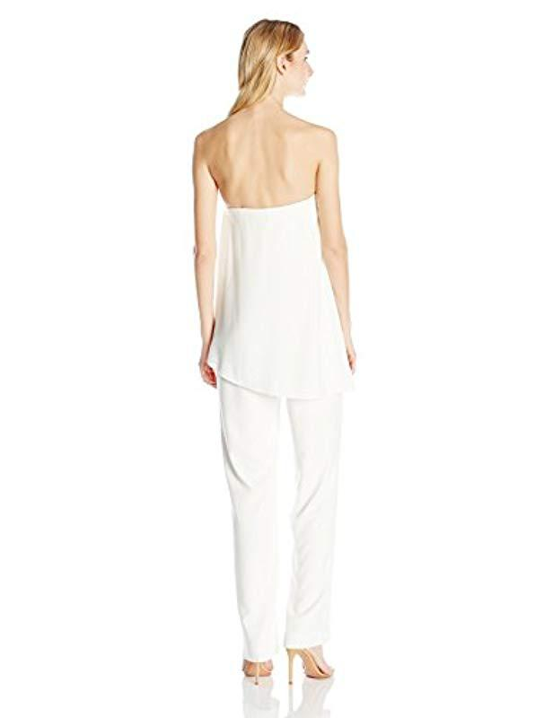 eb6eec42ea4b Lyst - Halston Strapless Asymmetrical Overlay Jumpsuit in White - Save 13%