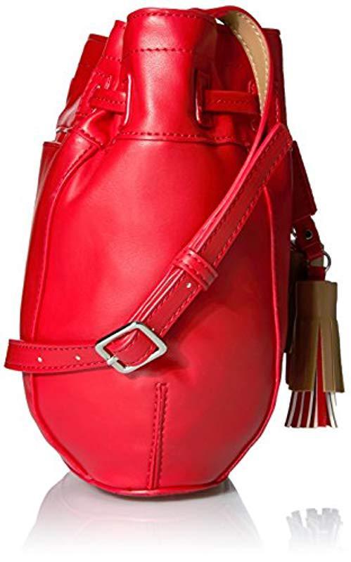 ac68355c24dc0 Nine West - Red Take A Lift Crossbody Bucket Bag - Lyst. View fullscreen