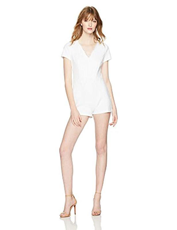 23985d3ed9d Lyst - Guess Short Sleeve Arabella Lace Mix Romper in White - Save 36%
