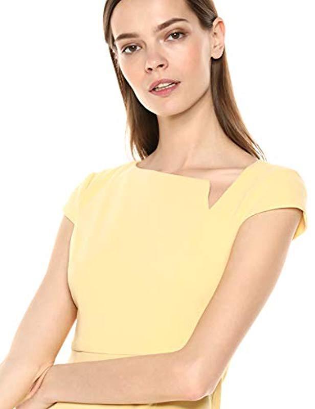 1251a612 Donna Morgan Crepe Sheath Dress With Asymmetrical Neckline in Yellow - Lyst